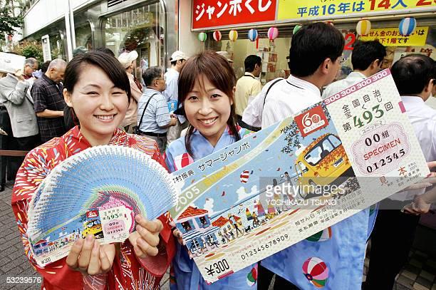 Campaign girls in yukata dress or summer kimono Yuri Yoshida and Yasuyo Matsuki display lottery tickets and its large sample as the 300 million yen...
