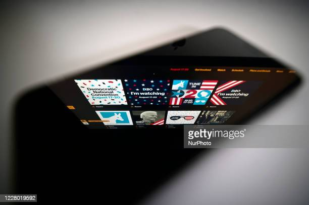 Campaign graphics for social media found on the website for the Democratic Convention are reflected on the screen of a phone in a photoillustration...
