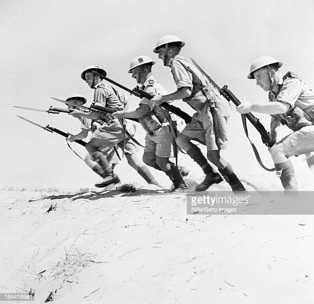 Campaign In North Africa 1940 1943 Men of the 51st Highland Division charging with fixed bayonets during a training exercise in the desert 23...