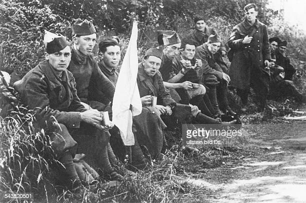 2WW Campaign in the west / battle of France 1005 French soldiers surrender With white flag sitting on the roadsideabout