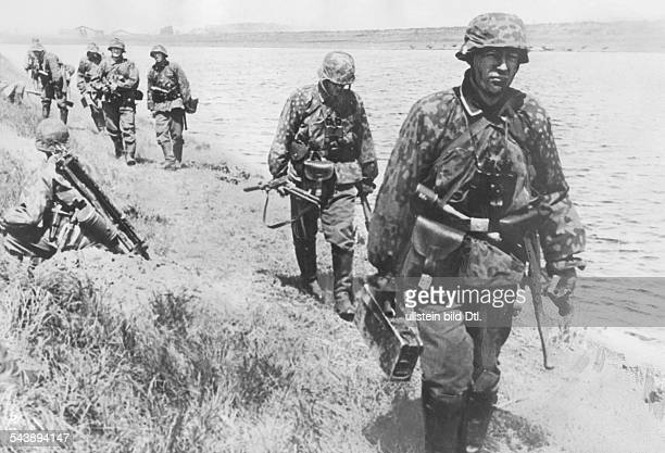 2 WW campaign in the west / battle of france 1005 Soldiers of the WaffenSS at the Meuse river or Albert canalabout 14May 1940 No further information...