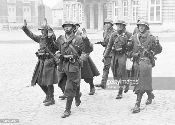 2WW Campaign in the west / battle of France 1005 Surrender of french soldiers conducted to an assembly camp by german soldiers End of May 1940