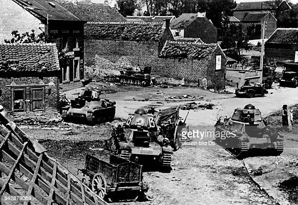Campaign in the west / battle of france :wrecked french tanks at village entrance. No further information ca.