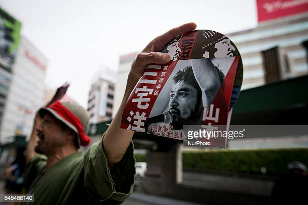 Campaign leaflets being distributed during the Upper House election campaign outside of Ikebukuro Station two days before the election Tokyo Japan on...
