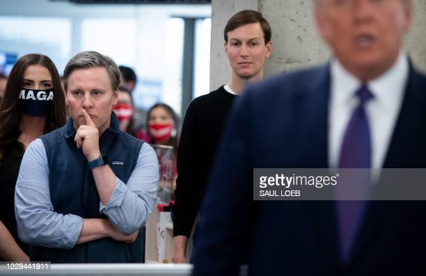 Campaign Manager Bill Stepien and White House Senior Advisor Jared Kushner listen as US President Donald Trump visits his campaign headquarters in...