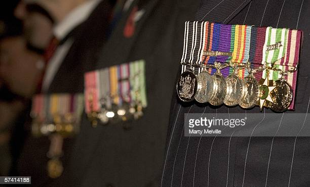 Campaign medals are seen prowdly worn by the old New Zealand soliders as they stand to attention and listen to the service during the dawn ceremony...