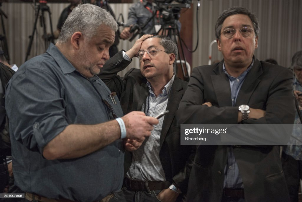 Campaign officials for Senator Alejandro Guillier, presidential candidate for the New Majority coalition, not pictured, react to exit poll results at the party's headquarters after the second round presidential general elections in Santiago, Chile, on Sunday, Dec. 17, 2017. BillionaireSebastian Pineraswept to victory in the run-off of Chile's presidential election, winning by a wider than expected margin, after pledging to reverse four years of sluggish economic growth. Photographer: Tamara Merino/Bloomberg via Getty Images