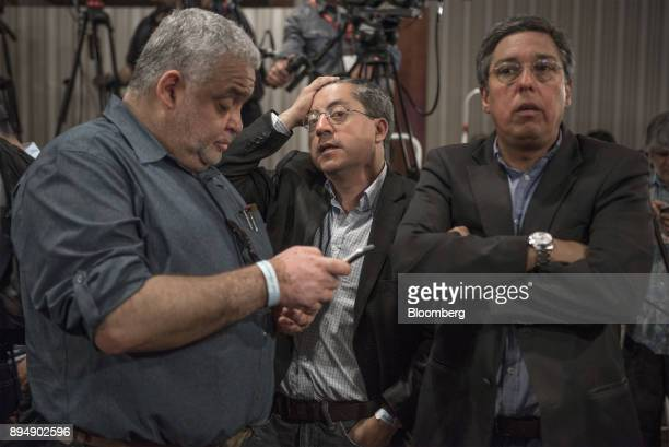 Campaign officials for Senator Alejandro Guillier presidential candidate for the New Majority coalition not pictured react to exit poll results at...