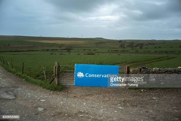 A campaign poster for the Conservative party sits next to a dry stone wall in rural Cumbria ahead of the Copeland byelection on February 16 2017 in...
