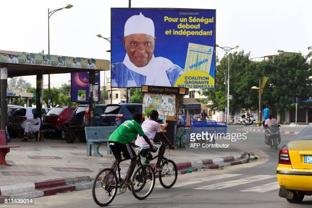A campaign poster of former Senegalese President Abdoulaye Wade is pictured in Dakar at the beginning of the campaign for the upcoming legislatie...