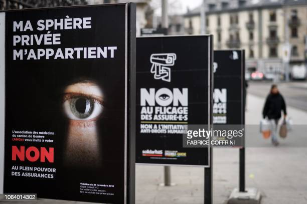 A campaign poster reading in French 'My privacy belongs to me' is seen on November 20 2018 in a street in Geneva prior to a referendum in Switzerland...