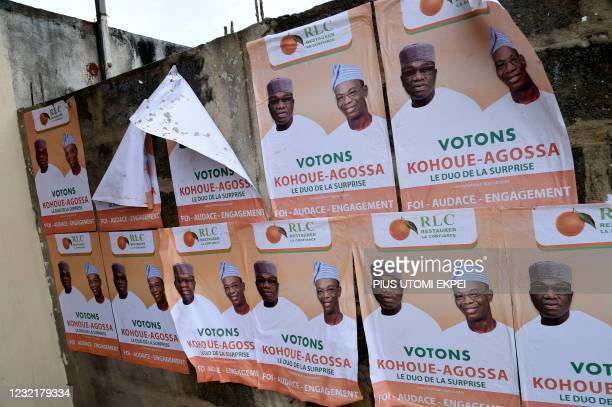 Campaign posters are displayed with photographs of the opposition Dynamics Restoring Confidence party candidate, Corentin Kohoue and running mate...