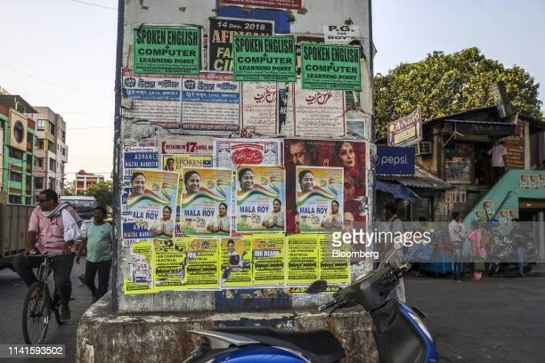 Campaign posters featuring West Bengal Chief Minister Mamata Banerjee are displayed in Kolkata, West Bengal, India, on Tuesday, April 30, 2019....