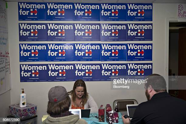 Campaign posters for Hillary Clinton former Secretary of State and 2016 Democratic presidential candidate hang on the wall behind League of...