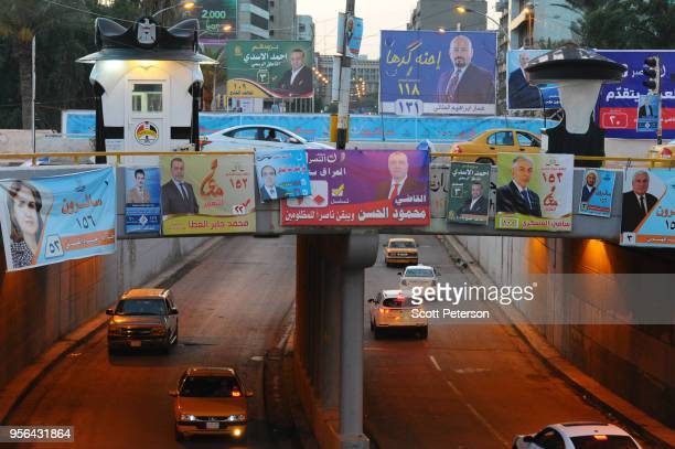 Campaign posters for Iraqi parliament candidate Ahmed alAsadi the former spokesman for Iraq's Shitte militias called the Popular Mobilization Forces...