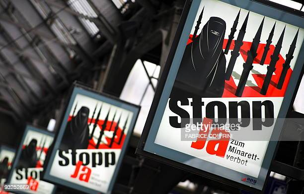 Campaign posters of the far-right Swiss People's Party depicting a woman wearing a burqa against a background of a Swiss flag upon which several...