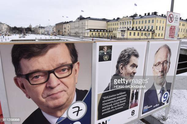 Campaign posters of the Finnish presidential candidates are seen during the presidential elections in Helsinki on January 28 2018 Finns were on...