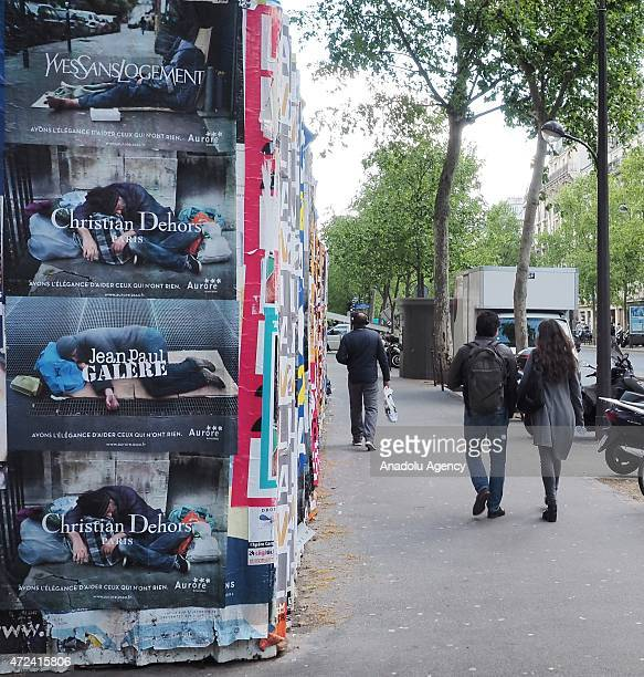 Campaign posters put up on Paris streets as part of a fashion icons' project aiming to help homeless people in Paris France on May 6 2015 A...