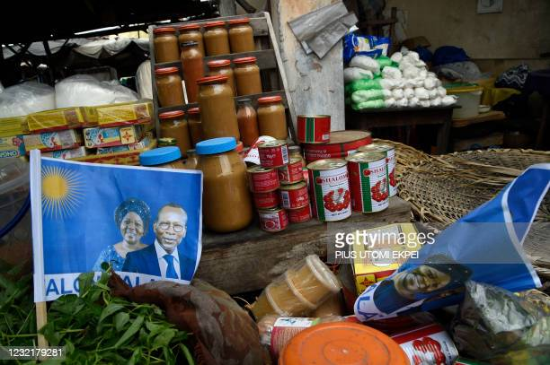 Campaign posters with photographs of incumbent Benin President Patrice Talon and running mate Mariam Talata are displayed in the market in Cotonou on...