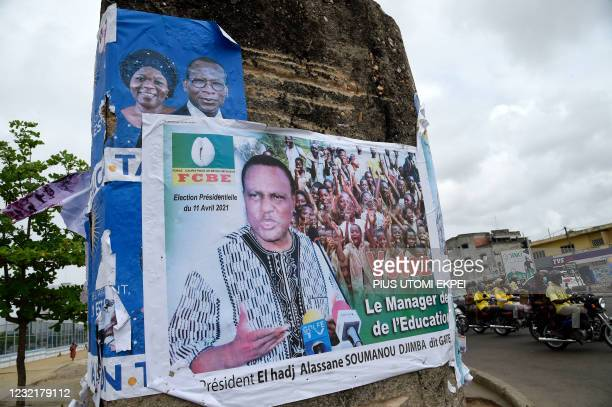 Campaign posters with photographs of incumbent President Patrice Talon and running mate Mariam Talata and the opposition Alassane Soumanou are seen...