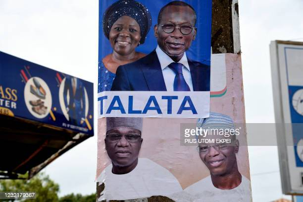 Campaign posters with photographs of incumbent President Patrice Talon and running mate Mariam Talata is displayed by the side of the opposition...