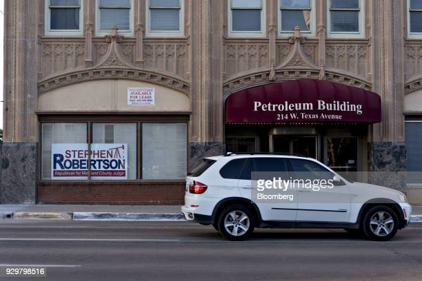 A campaign sign for a county judge candidate Stephen Robertson is displayed in a window of a building in downtown Midland Texas US on Thursday March...