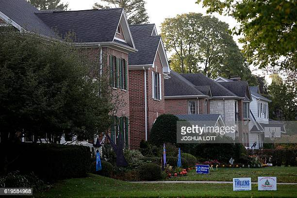Campaign sign for Democratic presidential candidate Hillary Clinton and her running mate Tim Kaine is displayed outside of a home on the same block...
