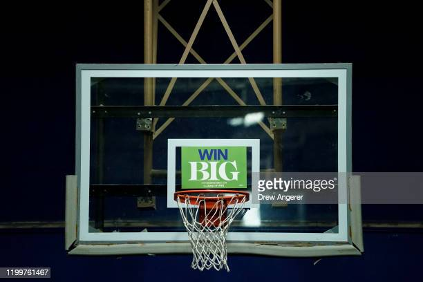 A campaign sign for Democratic presidential candidate Sen Amy Klobuchar sits on a basketball hoop during at a campaign event at the Woodbury School...