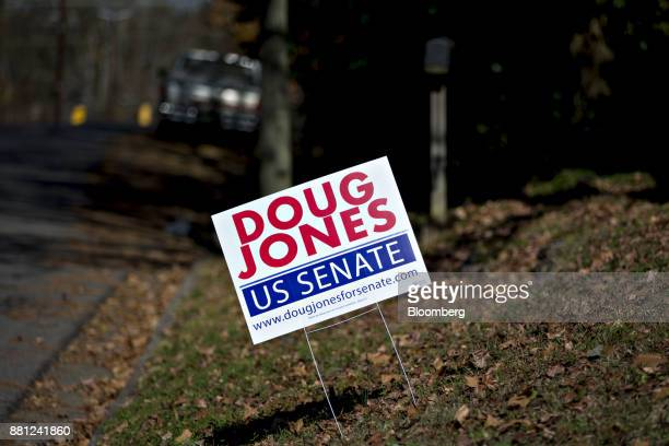 A campaign sign for Doug Jones Democratic US Senate candidate from Alabama stands in a yard in Gadsden Alabama US on Tuesday Nov 28 2017 On Sunday US...
