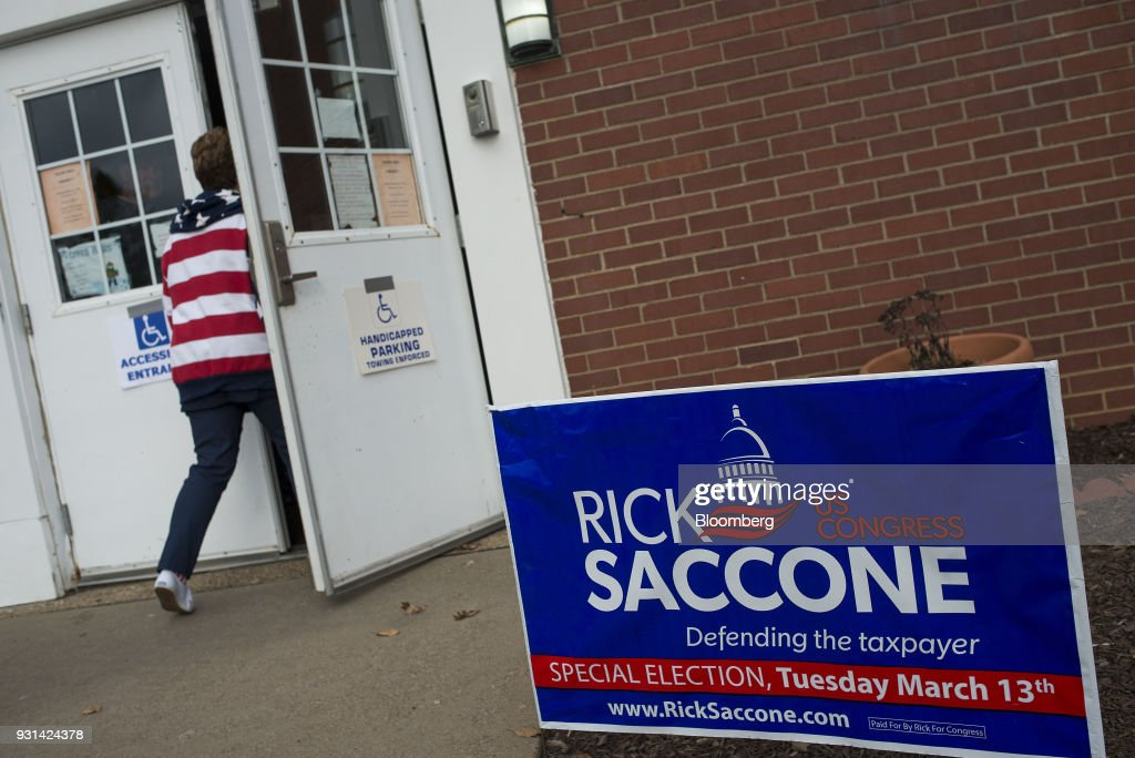 A campaign sign for Rick Saccone, Republican candidate for the U.S. House of Representatives, is displayed outside the Mount Vernon Presbyterian Church polling location in McKeesport, Pennsylvania, U.S., on March 13, 2018. Saccone and Democrat Conor Lamb are competing in the 18th District, where President Donald Trump won by almost 20 points in the 2016 presidential election, to replace Republican Tim Murphy who resigned last October amid personal scandal. Photographer: Ty Wright/Bloomberg via Getty Images