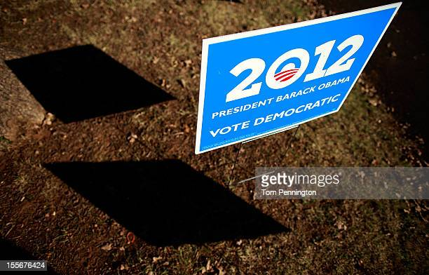 A campaign sign stands outside a polling location on November 6 2012 in Fort Worth Texas United States Americans across the country participate in...