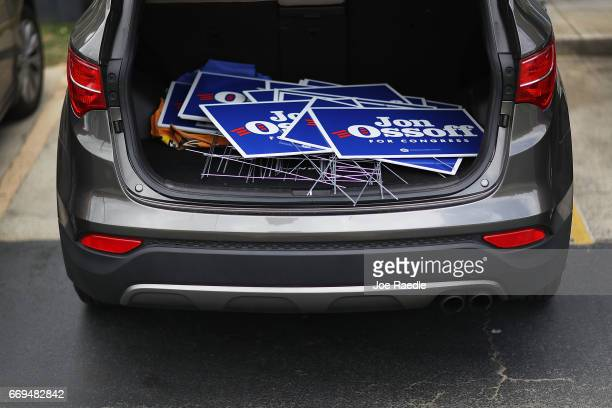 Campaign signs are piled in a vehicle as Democratic candidate Jon Ossoff visits a campaign office as he runs for Georgia's 6th Congressional District...