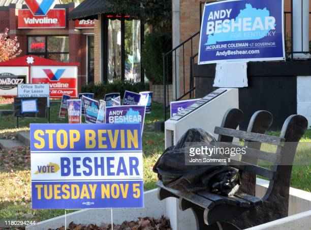 Campaign signs can be seen as a homeless person sleeps on a bench as voters go to the polls November 5 2019 in Louisville Kentucky Gov Matt Bevin a...