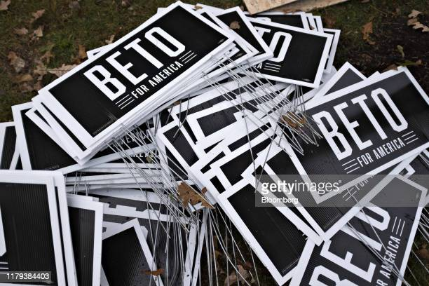 Campaign signs for Beto O'Rourke former Representative from Texas sit in a pile on the sidelines of the Iowa Democratic Party Liberty Justice Dinner...
