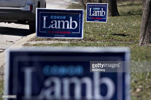 Campaign signs for Conor Lamb Democratic candidate for the US House of Representatives stand before a campaign rally with members of the United Mine...