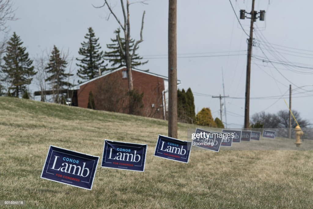 Campaign signs for Conor Lamb, Democratic candidate for the U.S. House of Representatives, are displayed on the side of a road in McKeesport, Pennsylvania, U.S., on March 13, 2018. Lamb and Republican Rick Saccone are competing in the 18th District, where President Donald Trump won by almost 20 points in the 2016 presidential election, to replace Republican Tim Murphy who resigned last October amid personal scandal. Photographer: Ty Wright/Bloomberg via Getty Images