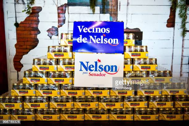 Campaign signs for Senator Bill Nelson a Democrat from Florida are dispalyed on cases of Medalla brand Puerto Rican beer during a Vecinos de Nelson...