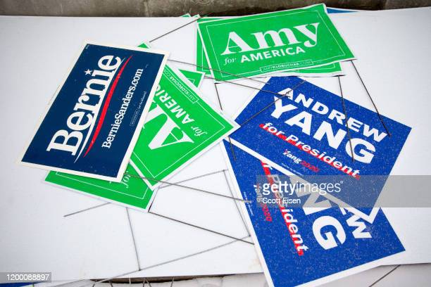 Campaign signs on the ground outside of the Webster Elementary School polling location during the presidential primary on February 11 2020 in...
