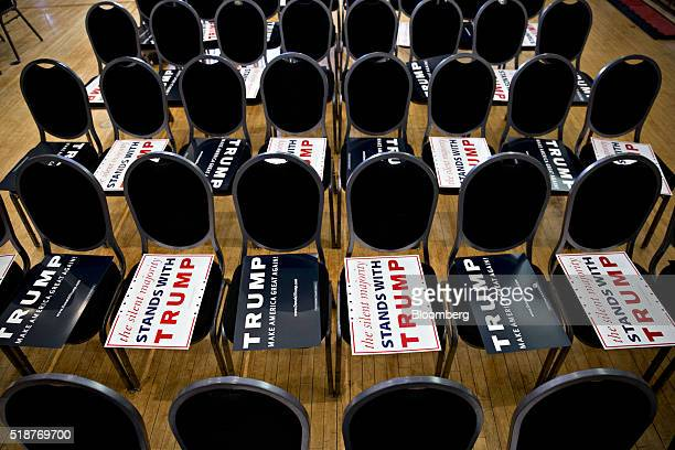 Campaign signs sit on chairs ahead of an event with Donald Trump president and chief executive of Trump Organization Inc and 2016 Republican...