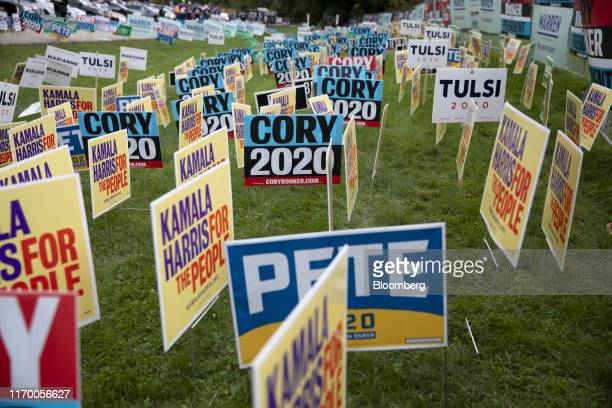Campaign signs stand during the Polk County Steak Fry in Des Moines Iowa US on Saturday Sept 21 2019 Presidential candidates gather in Iowa for the...