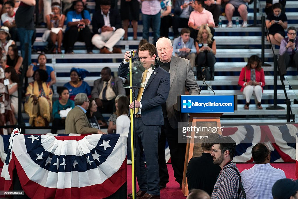 Campaign staff members measure a teleprompter on the stage prior to a primary night rally for Democratic presidential candidate Hillary Clinton at the Duggal Greenhouse in the Brooklyn Navy Yard, June 7, 2016 in New York City. Clinton has secured enough delegates and commitments from superdelegates to become the Democratic Party's presumptive presidential nominee. She will become the first woman in U.S. history to secure the presidential nomination of one of the country's two major political parties.