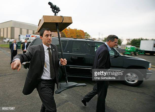 Campaign staffer Frank LaRose carries the podium that will be used by Republican presidential nominee Sen John McCain during a campaign rally at...