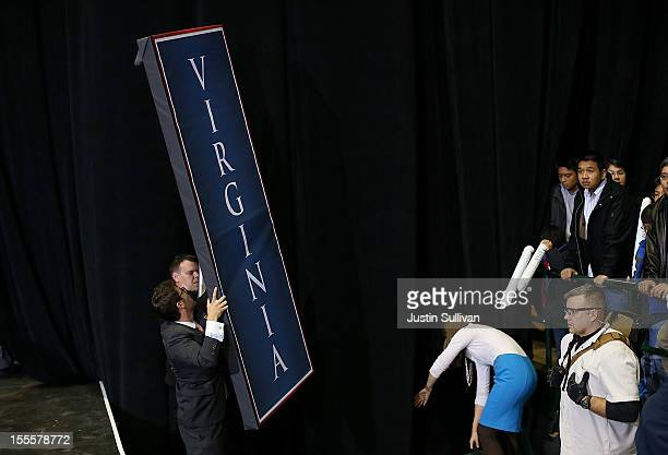 Campaign staffers for Republican presidential candidate former Massachusetts Gov Mitt Romney remove a sign at the end of a campaign rally at George...