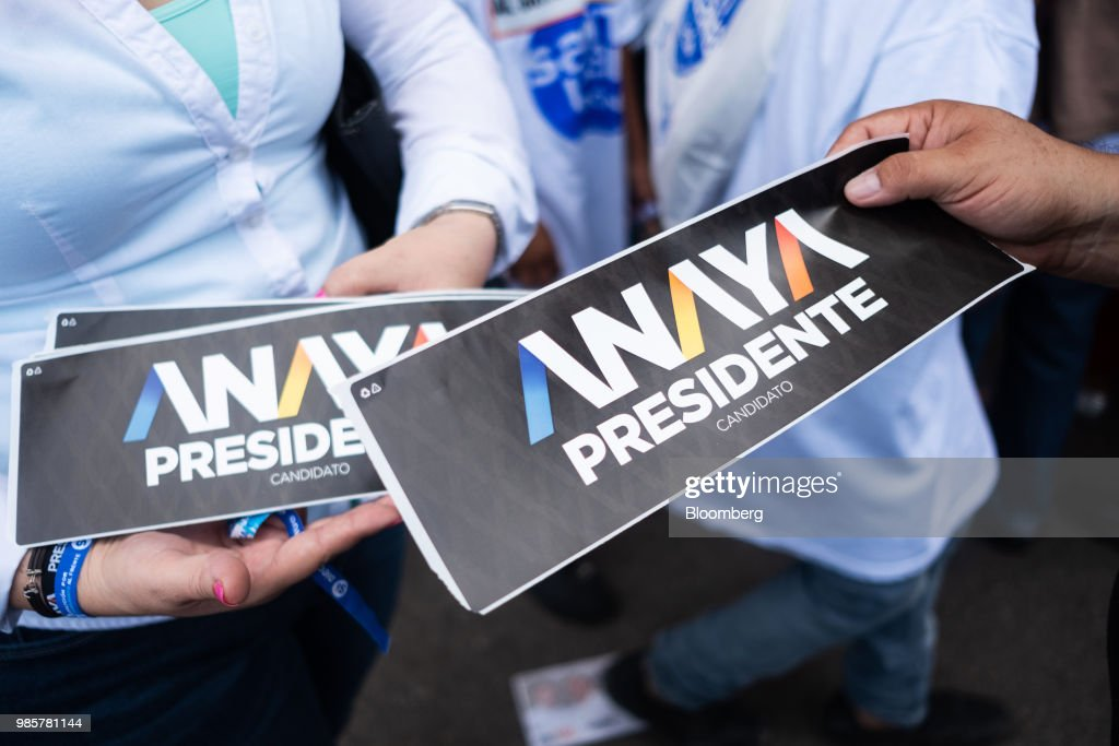 Campaign stickers are handed out during the final campaign rally for Ricardo Anaya, presidential candidate for the National Action Party (PAN), in Guanajuato, Mexico, on Wednesday, June 27, 2018. With just four short days before what's likely to be a historic presidential election in Mexico, were about to enter a blackout period. It's the last day for political advertising, campaign events and publishing new polls. Photographer: Mauricio Palos/Bloomberg via Getty Images