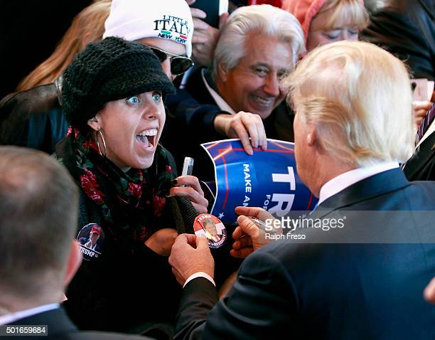 A campaign supporter reacts as Republican presidential candidate Donald Trump signs her button during a campaign event at the International Air...