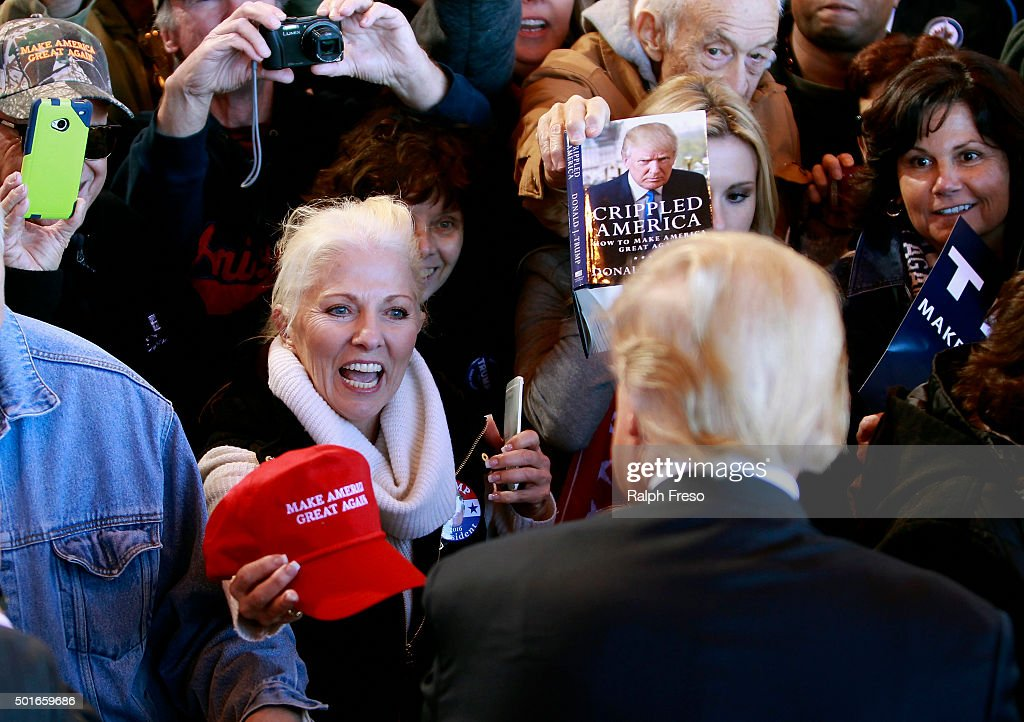 A campaign supporter tries to get her hat signed by Republican presidential candidate Donald Trump during a campaign event at the International Air Response facility on December 16, 2015 in Mesa, Arizona. Trump is in Arizona the day after the Republican Presidential Debate hosted by CNN in Las Vegas, Nevada.