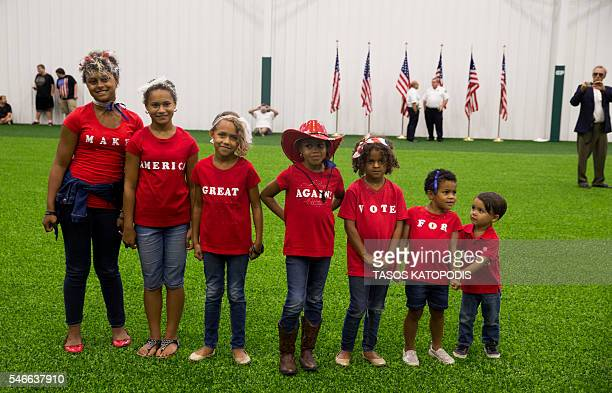 TOPSHOT Campaign supporters await the arrival of presumptive US Republican presidential candidate Donald Trump during a campaign rally at Grant Park...