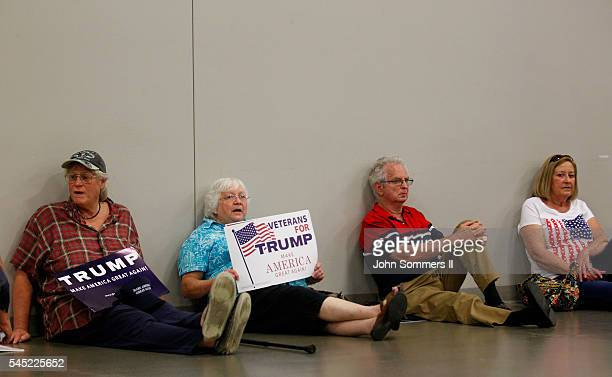 Campaign supporters relax as they wait to see Republican Presidential candidate Donald Trump before a campaign rally at the Sharonville Convention...