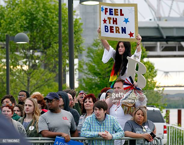 Campaign supporters show their support for Democratic presidential candidate Bernie Sanders as he speaks to them during a campaign rally at the Big...