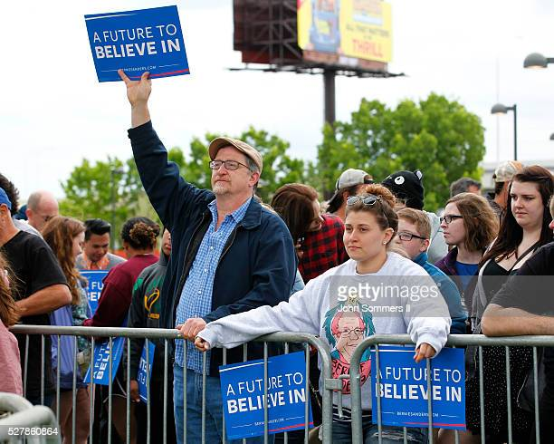 Campaign supporters show their support for Democratic presidential candidate Bernie Sanders before a campaign rally at the Big Four Lawn park May 3...